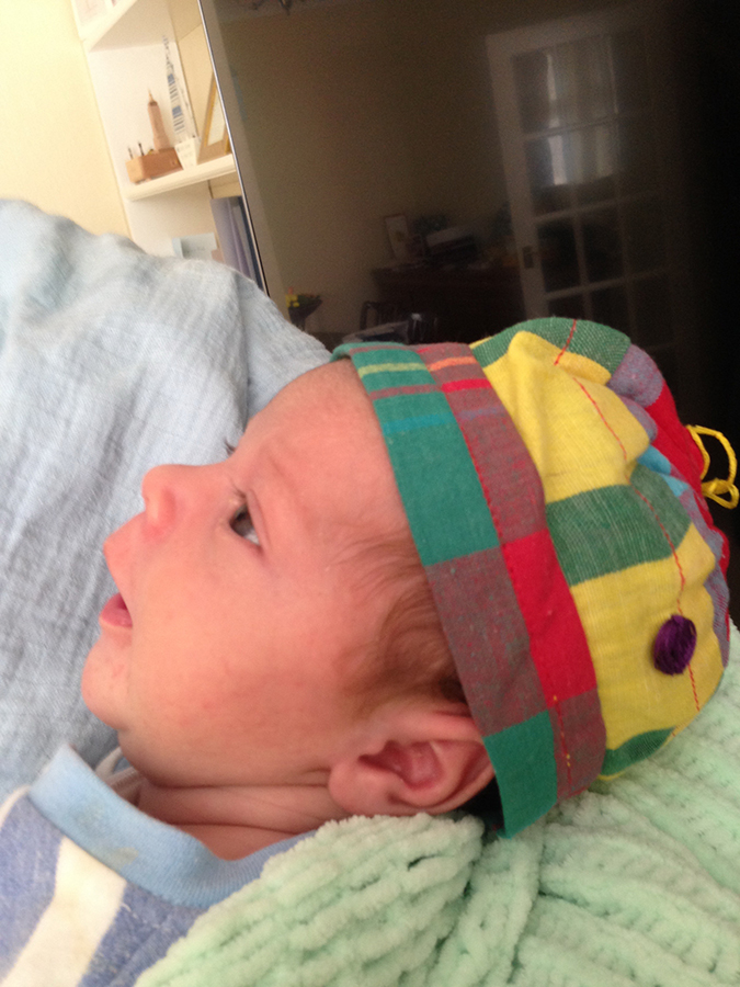 Saamaka baby cap sewn for James George Beck, born 1 April 2015 to Karla and Rich Beck, London.